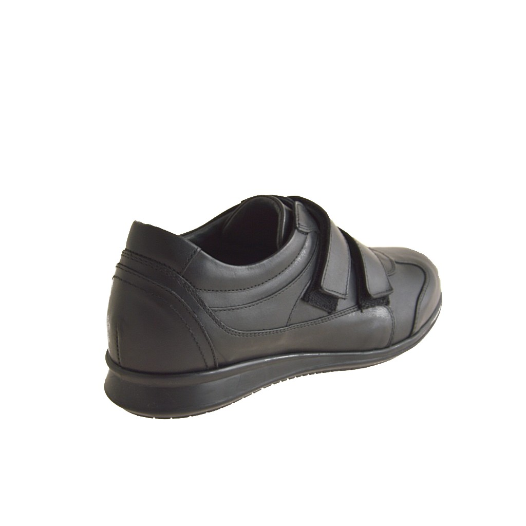 with Velcro bands in black leather