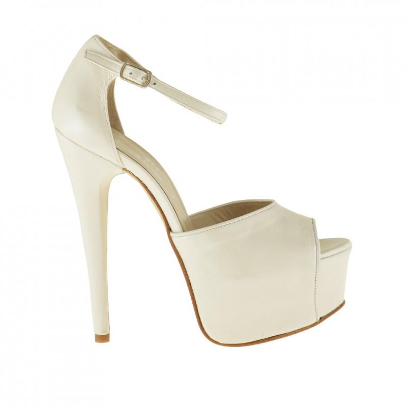 zapato de salon abierto con plataforma y cinturon al tobillo en piel