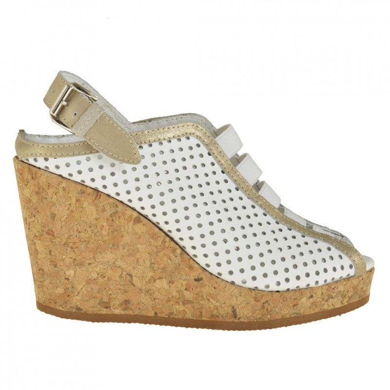 Woman ankle high sandal with elastic bands and cork wedge and platform in white pierced leather - Available sizes:  42