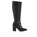 Woman's boot with zipper and three buckles in black leather heel 7