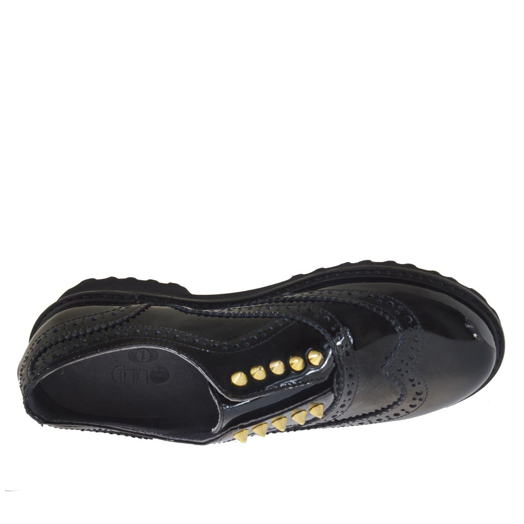 high fronted shoe with studs in black patent leather