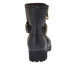 Woman's ankle boot with zipper, buckle and studs in black leather heel 3