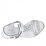 Woman's t-strap sandal in white pierced leather with cork platform and wedge 9