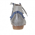 Woman's laced shoe with zipper in grey and blue pierced and newspaper printed leather