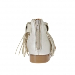 Woman's open strap shoe with zipper and fringes in platinum leather