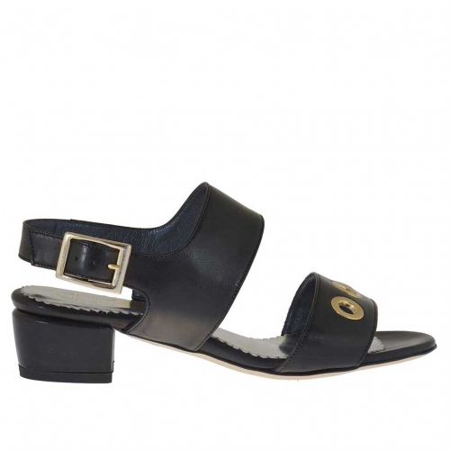 Woman's sandal with pierced gold studs in black leather heel 3
