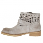 Woman's pierced boot with buckle and zipper in taupe vintage leather