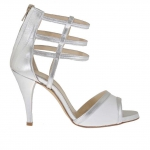 Open woman's platform pump with straps and zipper in white and silver laminated leather heel 9