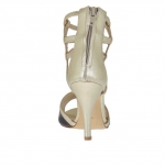 Open woman's platform pump with straps and zipper in black and platinum laminated leather heel 9
