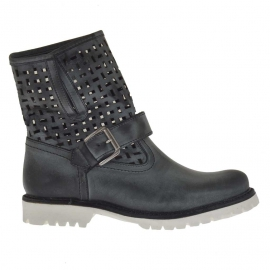 Woman's boot with buckle in black vintage pierced leather