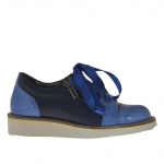 Woman's laced sport shoe with zipper in metallic denim blue patent leather and leather wedge 3