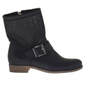 Woman's boot with buckle in black pierced leather
