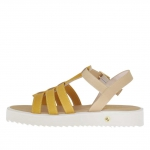 Woman's t-strap sandal in beige and ocher yellow printed leather wedge 2.5