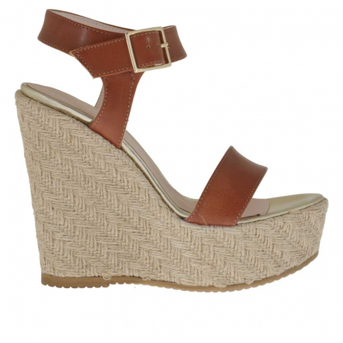 Woman's strap sandal in tan leather and golden patent leather with rope platform and wedge 12