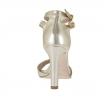 Woman's open pump with t-straps in platinum leather with wedge and heel 10