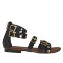 Chaussure ouvert pour femmes avec fermeture éclair, courroies, boucles et goujons or en cuir noir