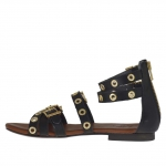 Woman's open shoe with zipper, straps, golden buckles and studs in black leather