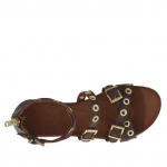 Woman's open shoe with zipper, straps, golden buckles and studs in dark brown leather