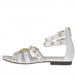 Woman's open shoe with zipper, straps, golden buckles and studs in white leather