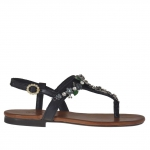 Woman's flip-flop sandal in black leather with flower decorations and strass