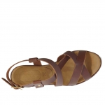 Woman's platform sandal with straps in tan leather wedge 9