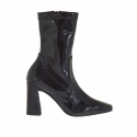 Woman's ankle boot with zipper in black patent leather and elastic patent leather heel 8