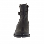 Woman's ankle boot with zipper and buckle in black leather and quilted leather heel 2