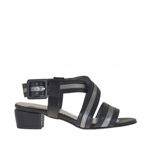 Woman's strappy sandal in black leather and laminated gunmetal leather heel 3 - Available sizes:  44, 46