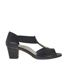 Scarpa aperta da donna con elastici e borchie in pelle nera tacco 4 - Misure disponibili: 34, 44, 46
