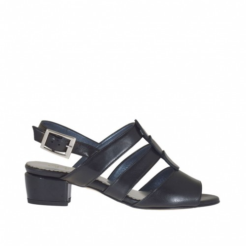 Woman's sandal in black leather and accessory in leather and patent leather heel 3 - Available sizes:  32