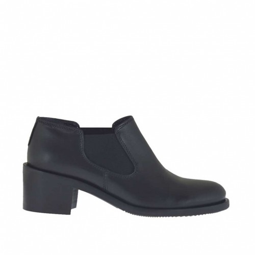 Woman's ankle-high shoe with rubber bands in black leather heel 5 - Available sizes:  34, 46