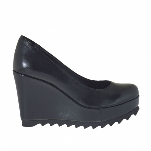 Woman's pump with coated wedge heel and platform in black leather wedge heel 9 - Available sizes:  44, 45