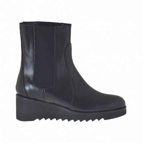 Botines para mujeres con elasticos en piel de color negro con cuña 5 - Tallas disponibles:  33, 42, 43, 44, 46, 47