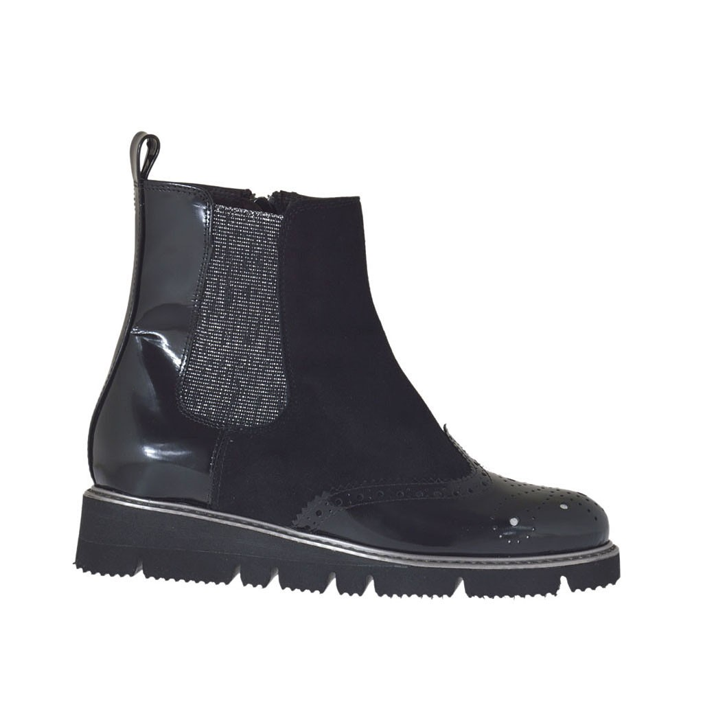 s ankle boot with zipper and silver elastic band in
