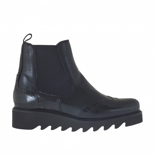 Woman's ankle boot with elastic bands in black leather and brush-off leather wedge heel 3 - Available sizes:  44