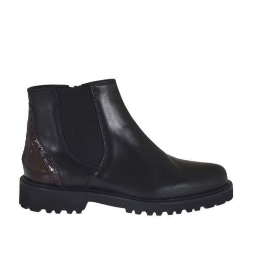 Woman's ankle boot with elastic band and zipper in black leather and maroon patent leather heel 3 - Available sizes:  32