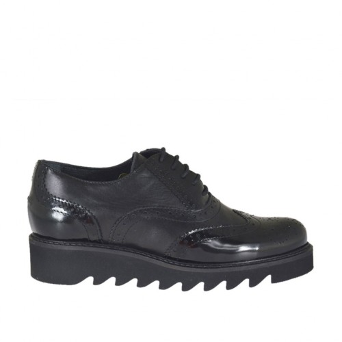 Woman's laced Oxford shoe in black leather and brush-off leather wedge heel 3 - Available sizes:  43