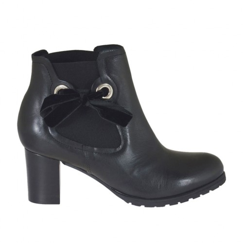 Woman's ankle boot with elastic bands and velvet bow in black leather heel 5 - Available sizes:  44