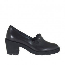 Woman's highfronted shoe with elastic bands and studs in black leather heel 6 - Available sizes:  32, 33, 34, 42, 43, 44