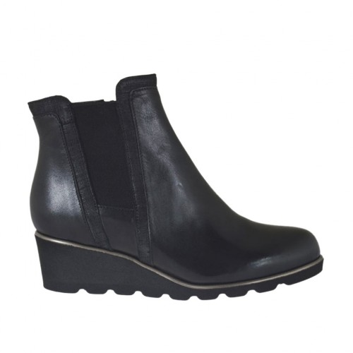Woman's ankle boot with elastic and zipper in black leather wedge heel 4 - Available sizes:  42