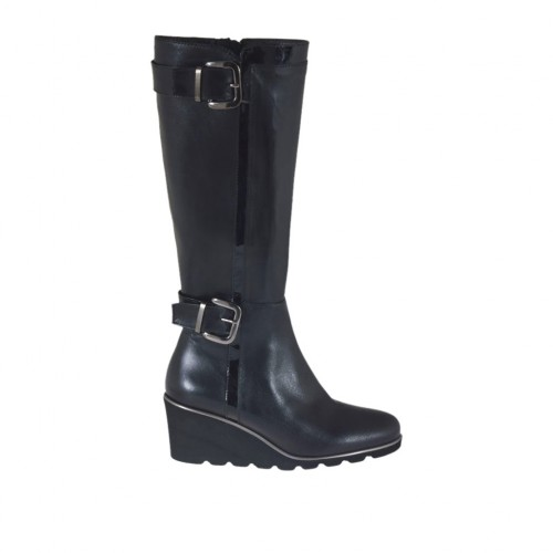 Woman's boot with zipper and buckles in black leather and patent leather wedge heel 6 - Available sizes:  42