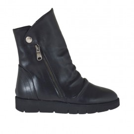 Woman's ankle boot with zippers and button in black leather wedge heel 3 - Available sizes:  33, 44