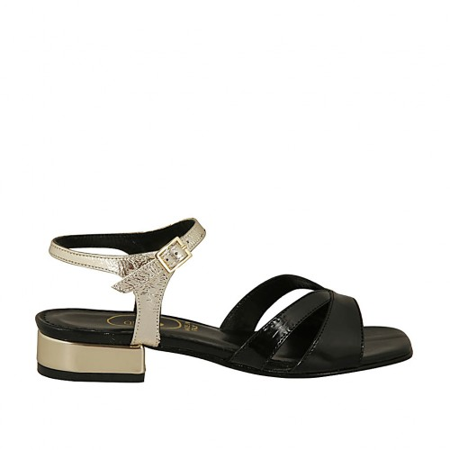 Woman's sandal with anklestrap in black patent leather and platinum laminated leather with heel 2 - Available sizes:  32, 33