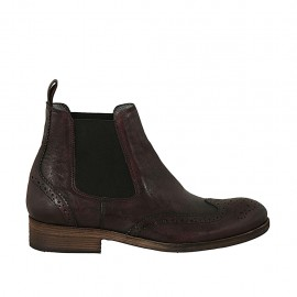 Men's elegant ankle boot with zippers and Brogue decorations in maroon leather - Available sizes:  37, 38, 47, 48, 49, 50