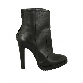 Woman's ankle boot in black leather with backside zipper, platform and heel 11 - Available sizes:  31, 32, 33, 34, 44, 45