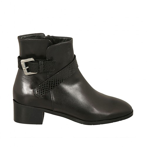 Woman's ankle boot with zipper and buckle in black leather and printed suede heel 4 - Available sizes:  45, 47