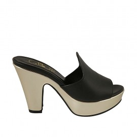 Woman's open mule in black leather and golden patent leather with platform and heel 10 - Available sizes:  33, 34, 42, 43