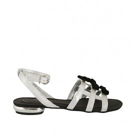 Woman's sandal with anklestrap in holographic white and rose printed leather with bows in black suede heel 1 - Available sizes:  33, 34, 42, 43, 44, 45