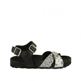 Woman's strap sandal with buckle in black leather and printed leather wedge heel 2