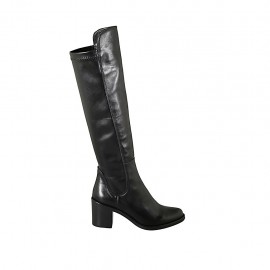 Woman's knee-high boot in black leather and elastic material heel 6